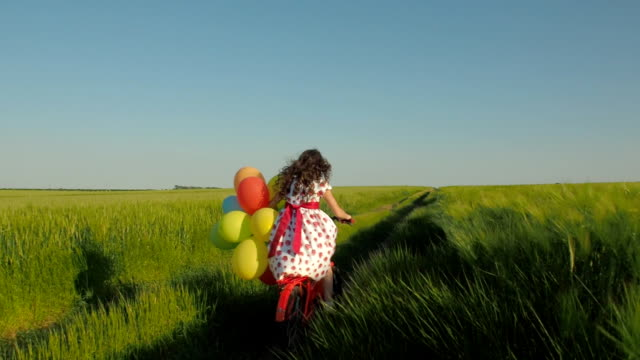 Child with balloons in the field video