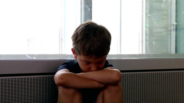 Child with crossed arms waiting at the airport. Kid with crossed arms putting his head down angrily video