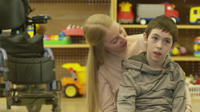 Child with Disability Laughing with Caregiver video