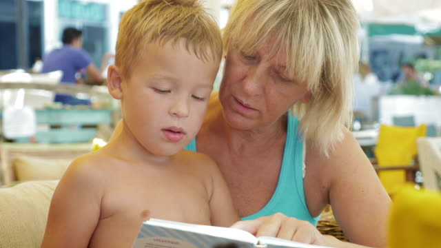 Child with grandmother and book video