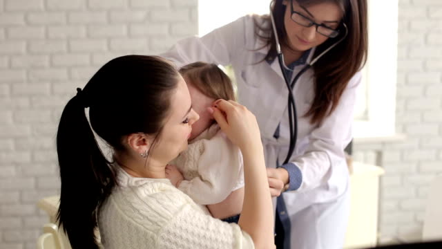 A child with her mother at a doctor's appointment. video