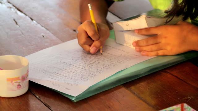 Child working on english homework video