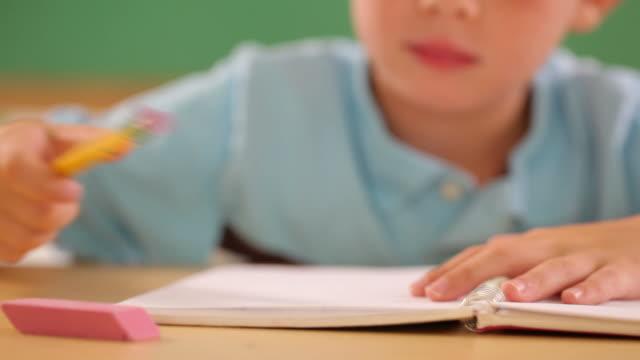 Child writing and erasing video