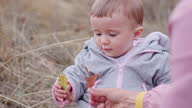 istock Childcare. Baby with mother learns to love nature. Teaching children about sustainability. 1347619085
