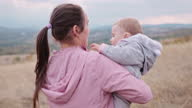 istock Childcare. Baby with mother learns to love nature. Teaching children about sustainability. 1347619109