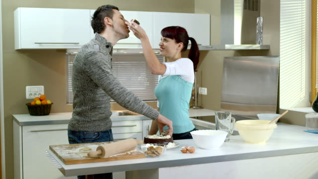 HD DOLLY: Childish Couple Eating A Cake With Hands video