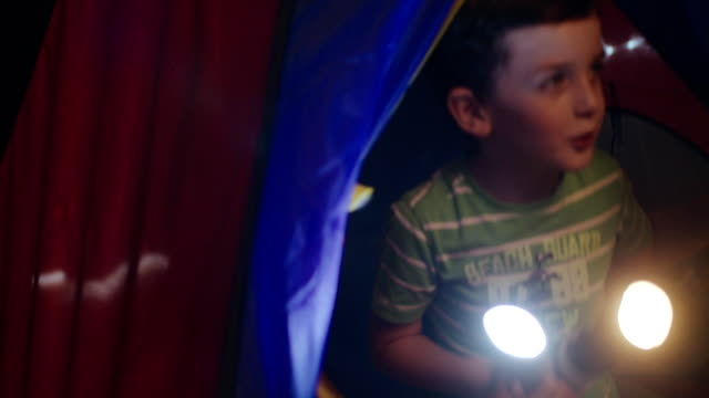 Children Are Playing In A Tent With Flashlights. Happy Little Girl And Boy Play In A Tent. Rays Of Flashlights. flashlight stock videos & royalty-free footage