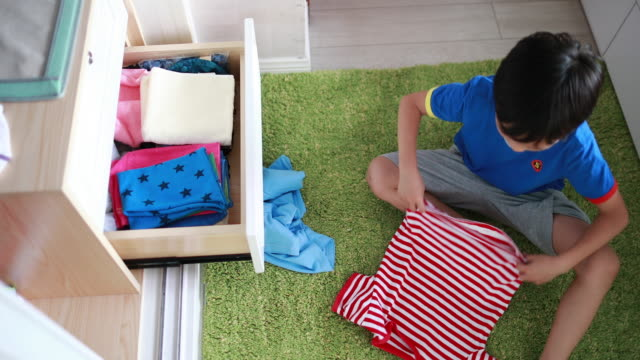 Children arranging her clothes Children arranging her clothes chores stock videos & royalty-free footage