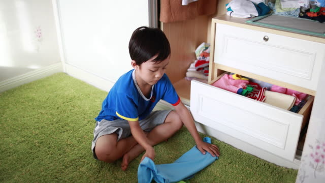Children arranging her clothes video