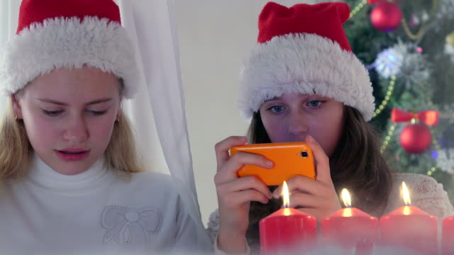Children at home using new smart phone gifted for Christmas video