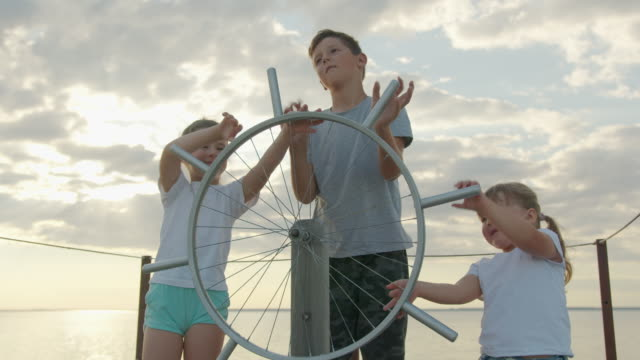 Children at the helm of the ship. happy childhood and adventure concept.