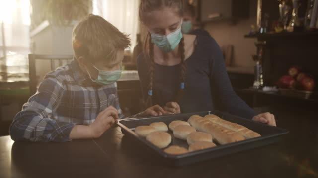 vídeos de stock e filmes b-roll de children baked bread buns at home - baking bread at home