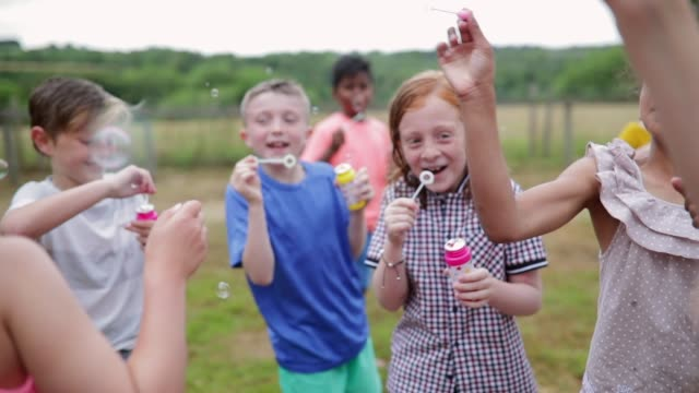 children blowing bubbles - memories stock videos & royalty-free footage