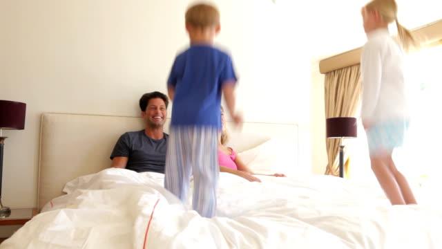 Children Bouncing On Parents Bed video