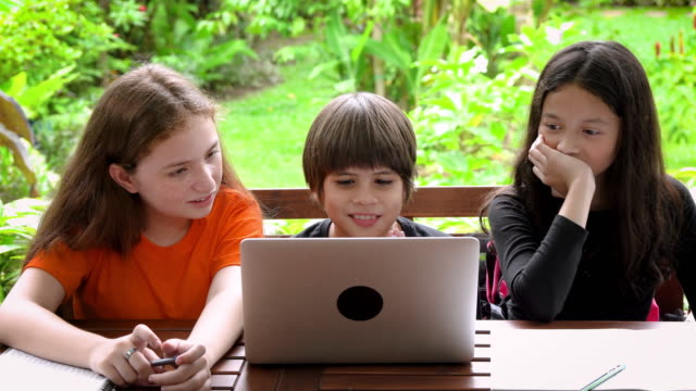 vídeos de stock e filmes b-roll de children, boy and girl, using laptop computer for online learning in garden at home - girl study home laptop front