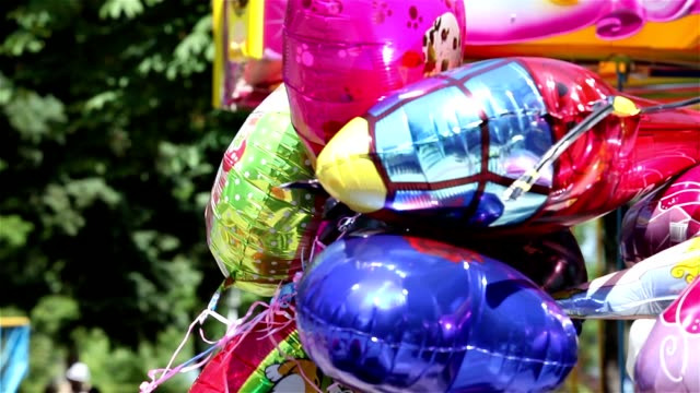 children colored balloons, metallic helium balloons, superheroes, superman, spiderman, inflatable toy holiday decoration metallic balloons kids toys foil balloon - aluminum foil stock videos & royalty-free footage