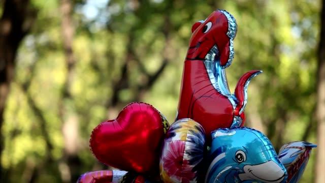 children colored balloons, metallic helium balloons, superheroes, superman, spiderman, inflatable toy holiday decoration metallic balloons kids toys foil balloon - metallizzato video stock e b–roll