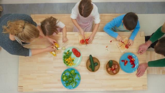 LD Children cutting vegetables at a kids' workshop