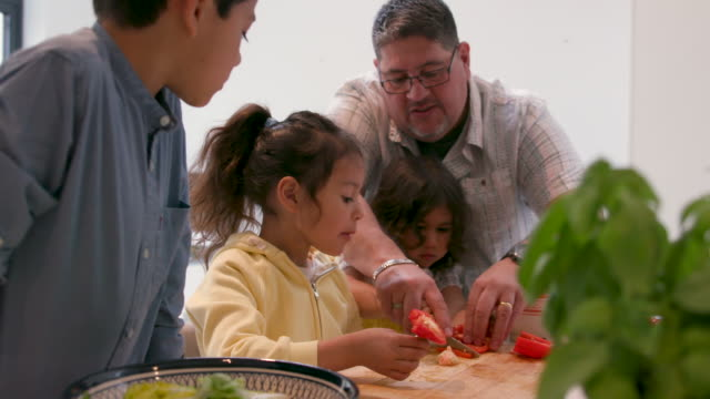 children cutting vegetables - preparing food together with their father - vegetarian stock videos & royalty-free footage
