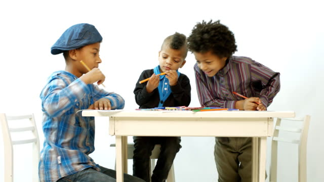 children draw at the table video