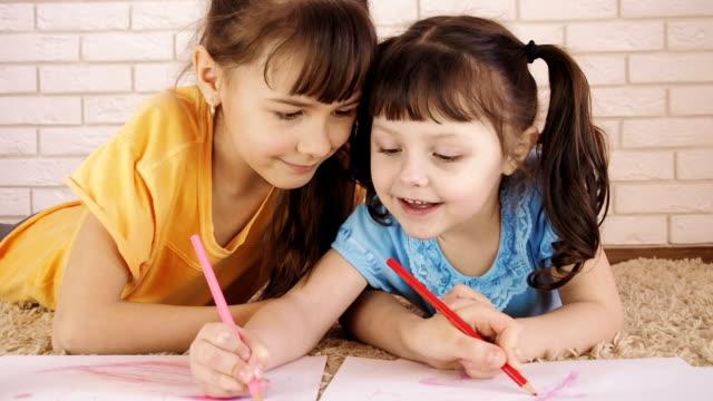 children draw together. - matita colorata video stock e b–roll