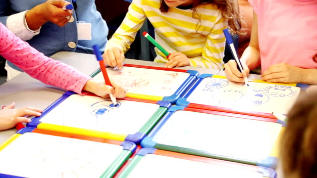 Children Drawing in Class video