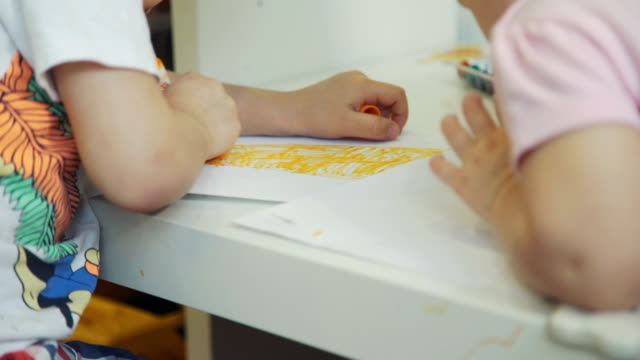 Children Drawing with Felt-tip Pens at Home Little Boy and his Cute Sister Drawing at the Table with Felt-tip Pens. Close-Up Shot child care stock videos & royalty-free footage