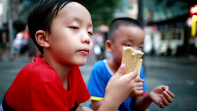 Children eat ice cream Children eat ice cream only boys stock videos & royalty-free footage
