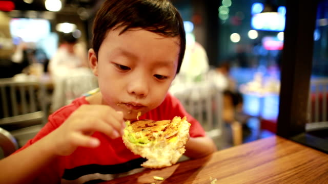 Children eat lunch Children eat lunch only boys stock videos & royalty-free footage