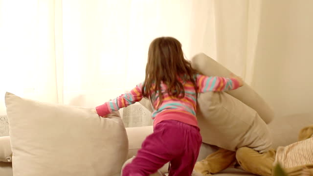 children fighting with pillows, wrestling and tickling each other. - wrestling stock videos and b-roll footage