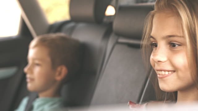 Children get in the car fastening seat belts video