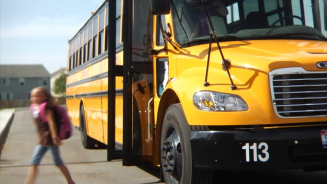 children get off school bus - school buses stock videos and b-roll footage