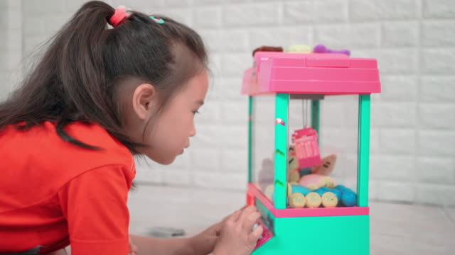 Children girl are playing keep box toy