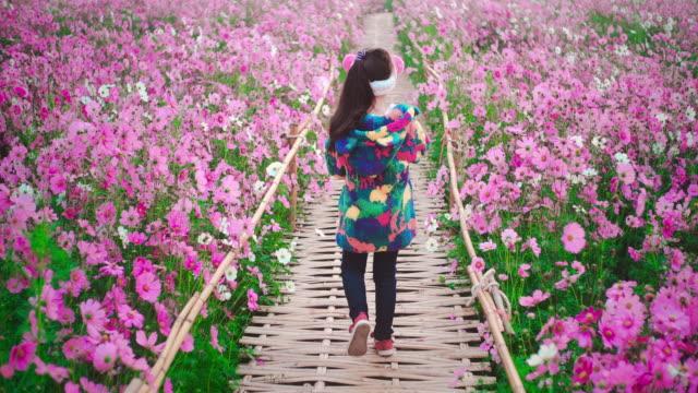 SLO MO Children girl walking in flower field