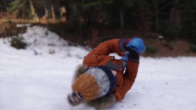 Children having fun playing in the snow