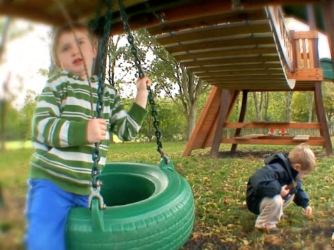 Children in a spin Cute little boys playing outdoors. High quality HD video footage outdoor play equipment stock videos & royalty-free footage