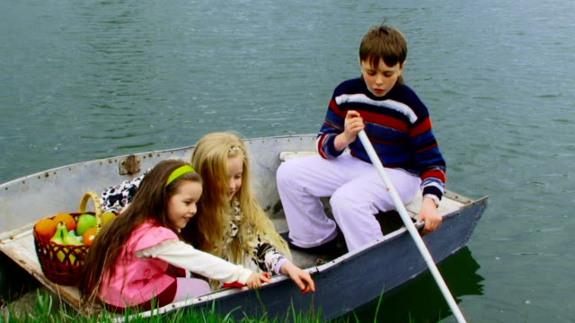 Children in boat Children in boat on lake. cousin stock videos & royalty-free footage