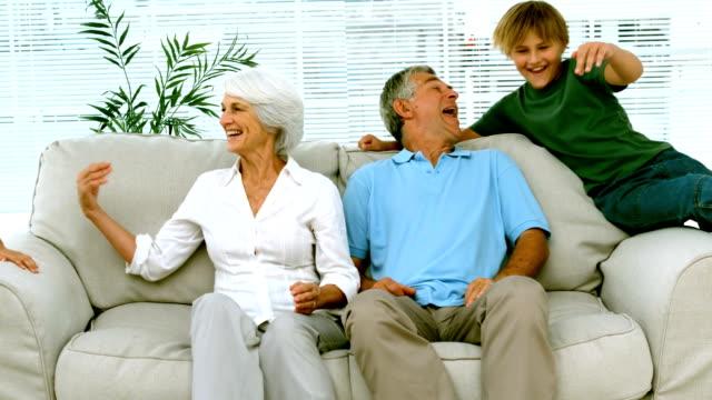 Children jumping on grandparents video