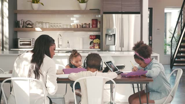 Children learn from home as mom telecommutes from home during COVID-19