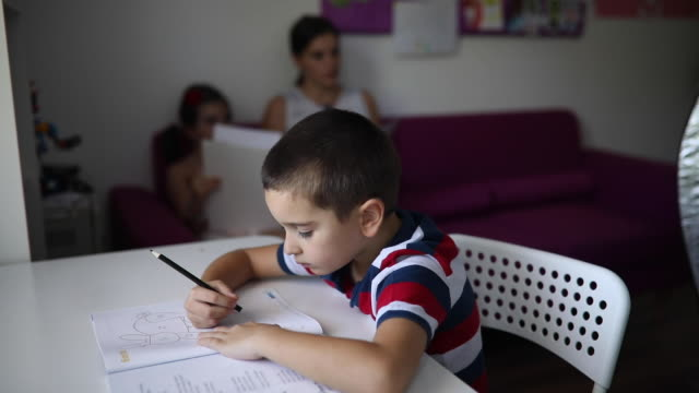 Children learning with a help of their teacher