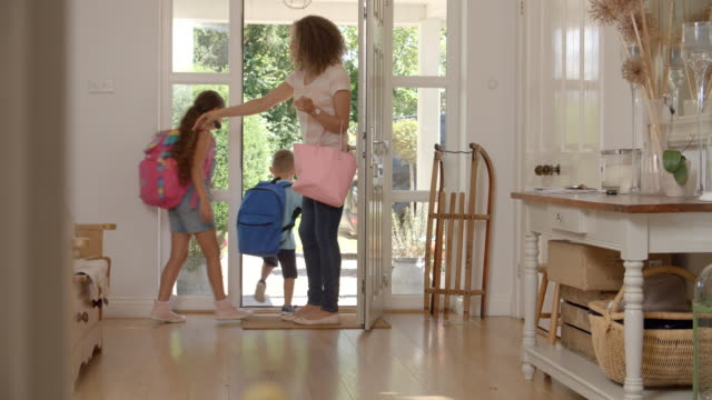 Children Leaving Home For School With Mother video