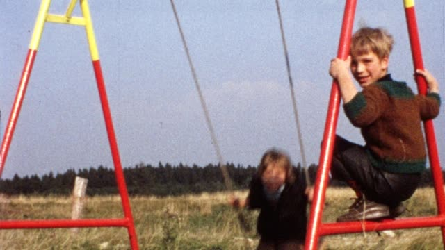 Children on swing (vintage 8mm film) video