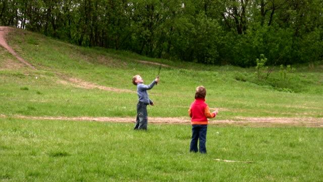 Children play badminton video