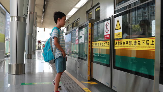 Children play in the subway Children play in the subway subway platform stock videos & royalty-free footage