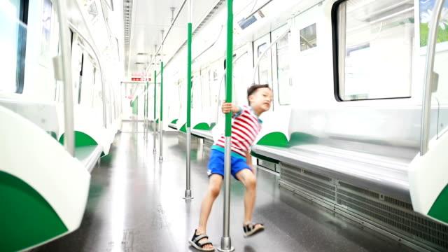 children play in the subway - solo bambini maschi video stock e b–roll