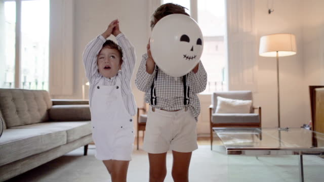 Children playing at home during Halloween
