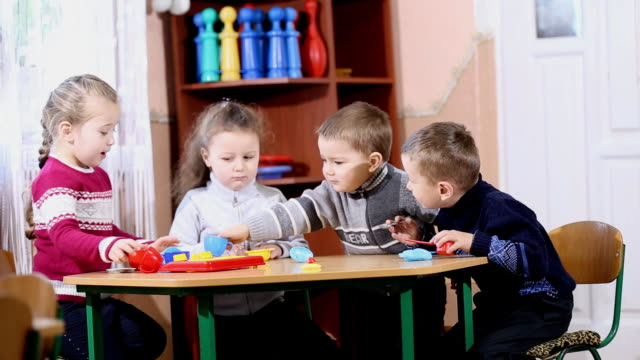 children playing at the table video
