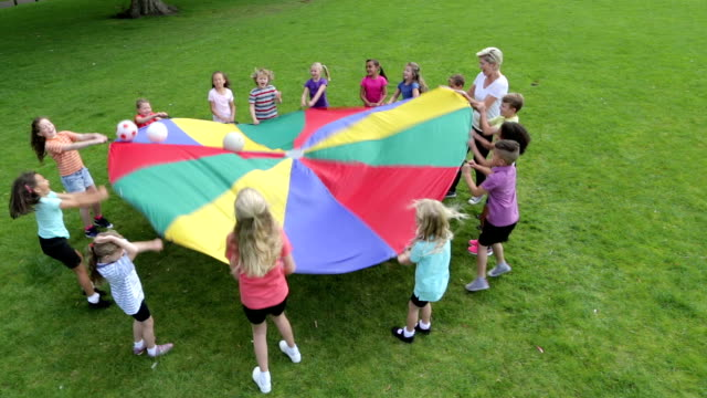 Children Playing Ball Games with a Parachute video