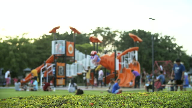 4K: Children playing in outdoor playground video