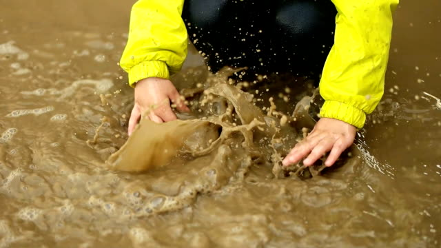 Children Playing in Rain Puddle Children Playing in Rain Puddle mud stock videos & royalty-free footage